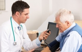 family doctor with older patient - Copy